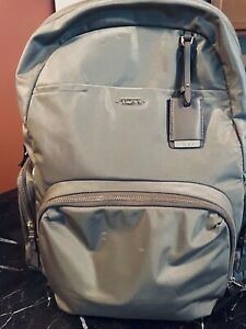 Tumi women's Backpack Mink with gold zippers