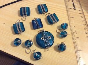 Blue glass wire wrapped beads, various sizes. 12 pieces. Set 58