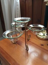 A GOLD TEA LIGHT / CANDLE HOLDER WITH 4 CLEAR GLASS HOLDERS