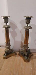 Paire de bougeoir en bronze et laiton pieds griffes époque Restauration XIXème