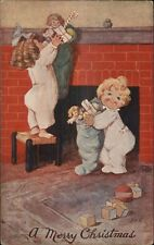 Christmas - Cute Kids Taking Down Their Stockings EHS c1910 Postcard