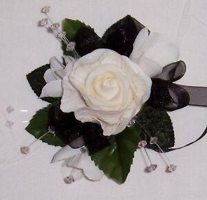 beautiful ivory rose & freesias wrist corsage with black ribbons wedding flowers