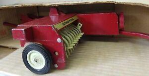 Vintage Ertl International Hay Baler with box.  #447