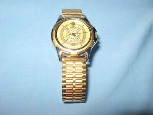Omega Psi Phi Gold Tone Analog Watch: Stretch Band