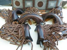5 leather and iron pool table pockets with tassels.