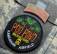 KANDAHAR AIRFIELD MUST-SMELL NUMBER ONE TOURIST ATTRACTION: POO POND + US FLAG