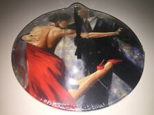 "Wall clock with photo of Tango dancers, 8"" in diameter, still in shrink wrap."