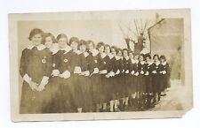 1930's SNAPSHOT: 17 YOUNG GIRLS IN A LINE WEARING IDENTICAL OUTFITS