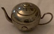 Antique nickel plated novelty travel inkwell in the space of a tea pot.