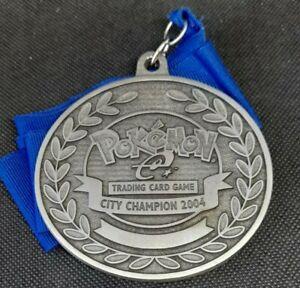 MEDAGLIA~POKÉMON~CITY~CHAMPION~2004~WINNER