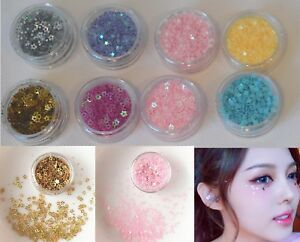 Nails or face art glitter stars hearts eyes sequins Festival eyeshadow make up