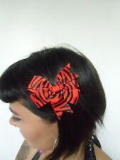 Pince clip cheveux noeud zèbre rayures noires rouge coiffure pinup rétro rockab