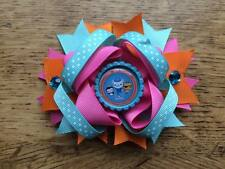 1 x 4.5 INCH OCTONAUTS RING HAIR BOW WITH GREEN BOTTLE CAP CENTRE +ALIGATOR CLIP