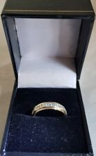A vintage 9ct White & Yellow Gold Eternity Ring. Claw set with White Sapphires