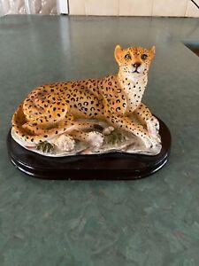 Cheetah Figurine on Wooden Base