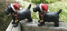 Pair of Scottie Dog Ornaments with Santa Hats and Bow and Bells