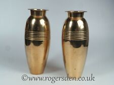 A Pair of Brass Vases