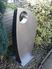 Large stainless steel garden sculpture.