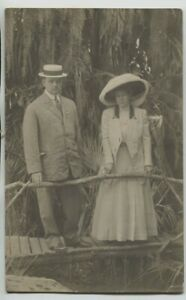 1910 St. Augustine Florida Man & Woman on walkway Real Photo Postcard RPPC