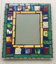 Mosaic Mirror. Blue, maroon, green, orangey/yellow tiles and tiles with designs
