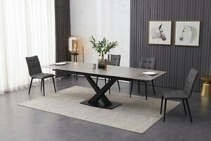 Grey ceramic dining table inc 8 grey faux leather chairs