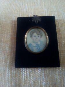 Black acorn frame portrait miniature painting young georgian boy with blue eyes.