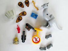 Lego, handcuffs, shields,dinosaur part,mini-fig cape, sign,mini dino tops parrot