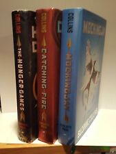Hunger Games Catching Fire Mockingjay HCs by Suzanne Collins Scholastic