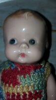 "Vintage 7"" plastic baby doll with crocheted dress no markings  (A1)"