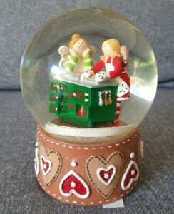 Musical glitter snow Globe, wind up, plays chestnuts roasting in an open fire