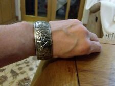 Brand new Tibetan silver cuff bangle with pictures all the way around