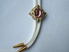 Bolo tie filigree surround and stone centre.rock and roll country and western.