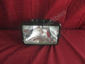 NOS OEM Chevrolet Sealed High Beam Head Light w/ Black Retaining Ring Right Hand