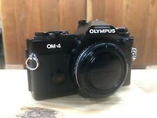 Olympus OM4, Black with body cap and re-foam kit
