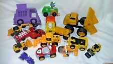 Lot of toy vehicles: cars, trucks, a helicopter, cycle, fire truck, etc.