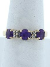 LADIES 14K YELLOW GOLD SYNTHETIC 4mm ROUND PURPLE AMETHYST 3 STONE BAND RING
