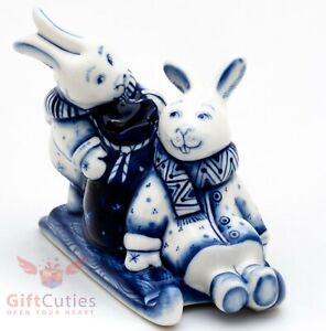 Gzhel porcelain figurine of Rabbits or Hare riding Sleds with beg of presents