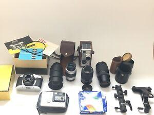 Konvolut Objektive Kamera EXA II a Sony Tamron, Vivitar, Nikon, Pentaka Polaroid