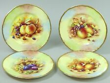 A SET OF FOUR CLAYTONBURY CHINA D.WALLACE STILL LIFE FRUIT PLATES