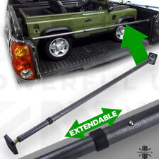 Extending rear load cargo bar telescopic locking load liner tie down bed rails