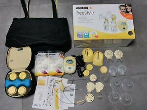 Medela Freestyle elektrische Doppel-Milchpumpe inkl. Flaschen, Akku, Tasche.....