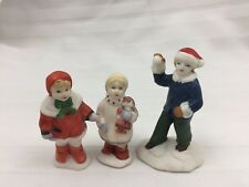 LOT OF 3 CHRISTMAS FIGURINES - 3 CHILDREN; ONE WITH DOLL, ONE WITH SNOWBALL