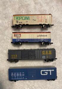 Lot of 4 N-scale Box Cars: GT, CSX, Johnson Wax, Tropicana