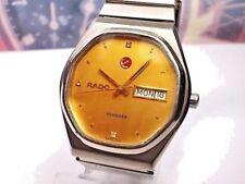 RELOJ RADO VOYAGER DAY/DATE AUTOMATICO CABALLERO MEN'S WATCH, GOLD DIAL