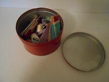 VINTAGE RED TIN WITH SEWING MATERIALS IN IT