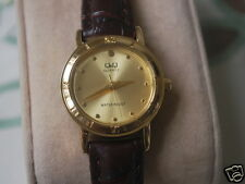Nice New Q&Q by Citizen Gold Tone Lady Dress Watch w/Brown Band & Golden Dial