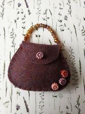 "Small handmade ""handbags"" filled with fragrant dried lavender. Maroon wool felt."