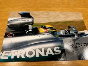 "Lewis Hamilton signed photo, Mercedes 2014, #KeepFightingMichael, 12"" x 7.5"""