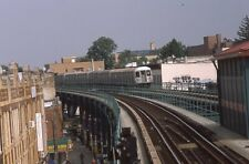 Nycta Transit slide. R42 subway train crossing 105th Street on curve. Woodhaven