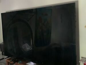 """65"""" TCL Roku Smart TV Black, Great condition. Comes with Roku remote."""